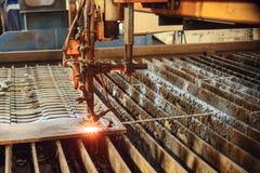 Oxygen torch cuts steel sheet. Stock Photos