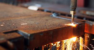 Oxygen torch cuts steel sheet. CNC gas cutting machine. Bright sparks. Of melting metal Stock Images