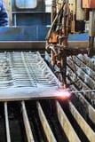 Oxygen torch cuts steel sheet. Stock Image