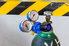 The Oxygen valve and pressure gage on tank. Royalty Free Stock Photography