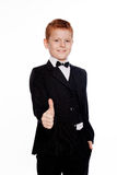 Вoy with red hair in a black suit with bow tieair in a black suit with bow tie Stock Image