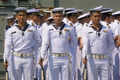 Oyal Thai Navy petty officers in summer white uniform hold M16 rifles with bayonets on board ship. CHONBURI, THAILAND - MARCH 15, 2018 : Royal Thai Navy petty Stock Images