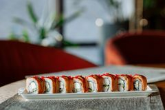 set sushi rolls on a gray napkin on the table royalty free stock image