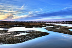 Oyster beds and harbor hdr. Hdr image of oyster beds and harbor at sunset Royalty Free Stock Images