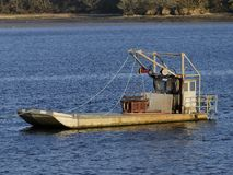 Oyster boat at anchorage. Stock Images