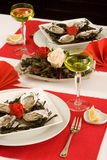 Oyster dinner. Elegant oyster dinner in red and white Stock Photo