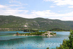 Oyster farms in a bay of the Mediterranean Sea Royalty Free Stock Images