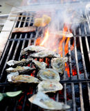 Oyster on fire Royalty Free Stock Photography
