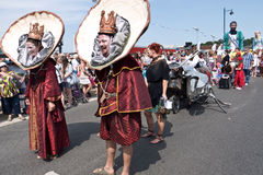 Oyster King and Queen in the parade, Whitstable UK. WHITSTABLE,UK-JULY 26: The Oyster King and Queen in costume take part in the Annual Oyster Festival Parade Royalty Free Stock Photo
