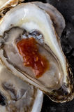 Oyster liquor and cocktail sauce Stock Image