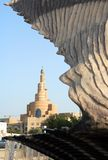 Oyster and minaret in Qatar. The minaret of Qatar Islamic Centre in the centre of Doha, seen through the Oyster fountain feature on the Corniche Royalty Free Stock Image