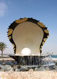 Oyster and pearl. Pearling water feature on Doha's Corniche. Part of the city's new high-rise development is visible behind it. (January 05 stock photo