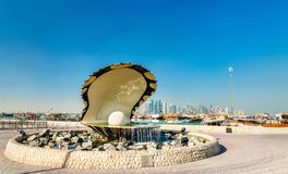 Oyster and Pearl Fountain on Corniche Seaside Promenade in Doha, Qatar. The Oyster and Pearl Fountain on Corniche Seaside Promenade in Doha, Qatar. The Middle Stock Photo