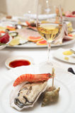 Oyster and prawn on plate Royalty Free Stock Photos