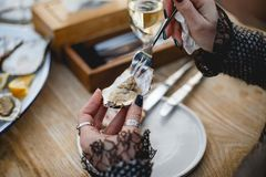 Oyster. Sea oyster in the hands Stock Photography