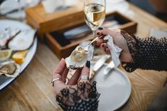 Oyster. Sea oysters with lemon on ice Royalty Free Stock Images