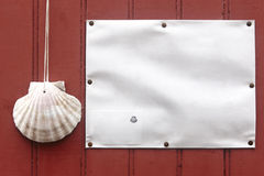 Oyster shell in a red door. Santiagos way symbol Stock Images