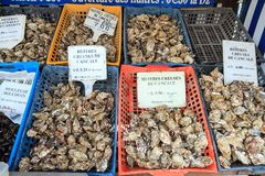 Oysters in baskets for sale. Crates with fresh oysters for sale at the french coast of Brittany Bretagne in Cancale, France, on August 1, 2014 Stock Photography
