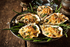 Oysters with Cheesy Gratin Topping Served on Plate Royalty Free Stock Images