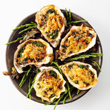 Oysters with Cheesy Gratin Topping Served on Plate Royalty Free Stock Photo
