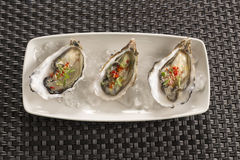 Oysters with chilli & ginger Stock Photo