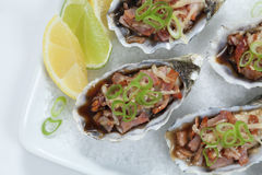 Oysters Kilpatrick close-up Stock Photos