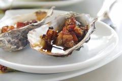 Oysters Kilpatrick Stock Image