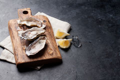 Oysters and lemon Stock Photos