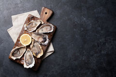 Oysters and lemon over ice Stock Images