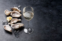 Oysters with lemon and white wine stock photography
