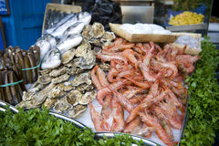 Oysters and prawns for sale. Fresh oysters and prawns at the fishmongers Stock Photo