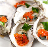 Oysters with red caviar Royalty Free Stock Photo