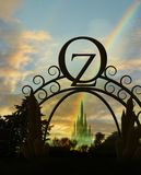 Oz gateway with rainbow. Ornate gateway to oz with emerald city and rainbow in background stock illustration