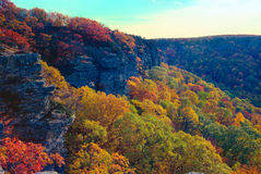 Ozark autumn. The limestone bluffs of Magazine Mountain rising above colorful fall foliage stock photo