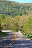 Ozark highway. A highway winds through the Ozark hills in Arkansas on a spring day Royalty Free Stock Images