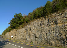 Ozark Mountain Highway. Steep rocky cliffs and trees line the hilly roads in the Ozark Mountains in Southwest Missouri Stock Image