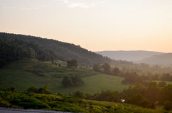 An Ozark Mountain View. A Grazing meadow at Sunset stock images