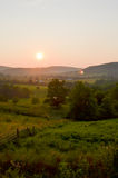 An Ozark Mountain View. A Grazing meadow at Sunset stock image