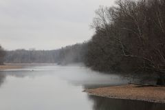 Ozark Winter River Mist. Deer Leap on the Current River Doniphan, MO.  Winter on the Ozark National Scenic Riverways Royalty Free Stock Photo
