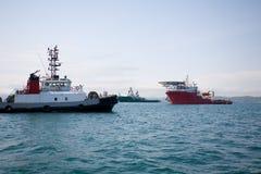 Ozean zerrt Boot Stockbilder