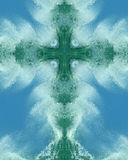 Ozeanspraykreuz Stockfoto