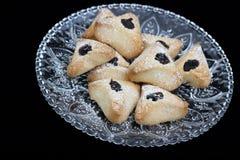 Ozney haman bakery symbol of the Jewish holiday of Purim. Hamantachen, traditional pastry on decorative plate for the Jewish holiday of Purim royalty free stock photography