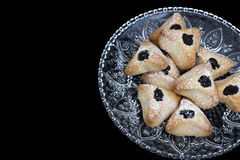 Ozney haman bakery symbol of the Jewish holiday of Purim. Hamantachen, traditional pastry on decorative plate for the Jewish holiday of Purim stock photos