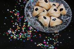 Ozney haman bakery symbol of the Jewish holiday of Purim. Hamantachen, traditional pastry on decorative plate for the Jewish holiday of Purim. Colorful royalty free stock photo