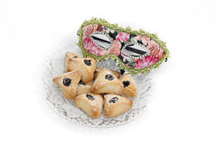 Ozney haman and masquerade mask symbols of the Jewish holiday of. Hamantachen, traditional pastry on decorative plate and a mask for the Jewish holiday of Purim stock images
