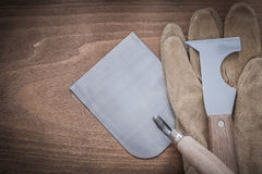 Pá de pedreiro de aço da alvenaria da faca de massa de vidraceiro e glov protetor de couro Fotos de Stock