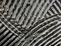 Pá de pedreiro na textura decorativa no cinza no interior da loja imagem de stock