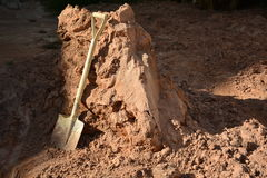 Pá e areia Imagem de Stock