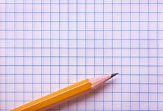 Página de papel com lápis Fotografia de Stock Royalty Free