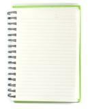 Página de papel de la derecha del cuaderno con el lápiz en el fondo blanco Foto de archivo libre de regalías